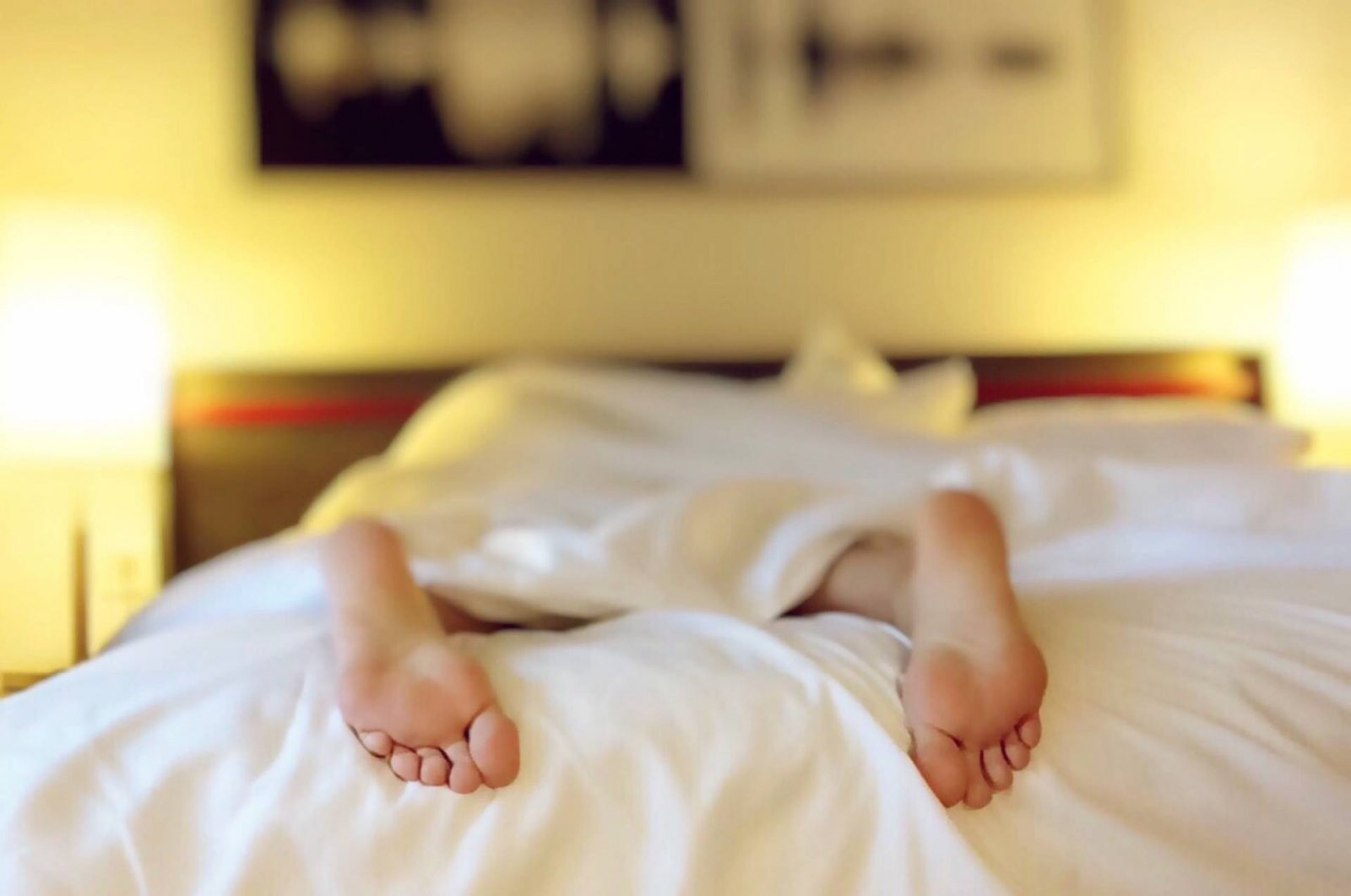 woman lying face down on bed tired jet lag