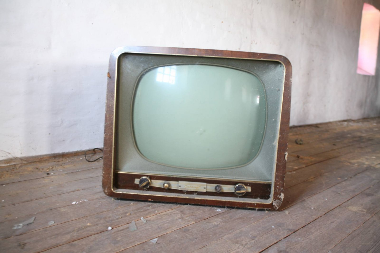 old tv on distressed wood floor parent hangover