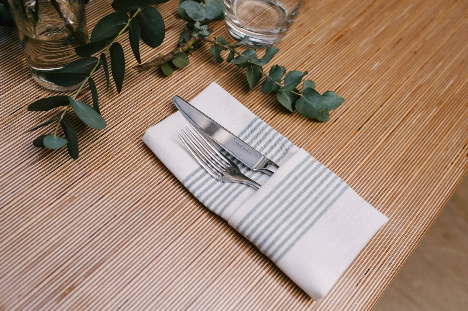 family dinner knife and fork on table in napkin jacket potato